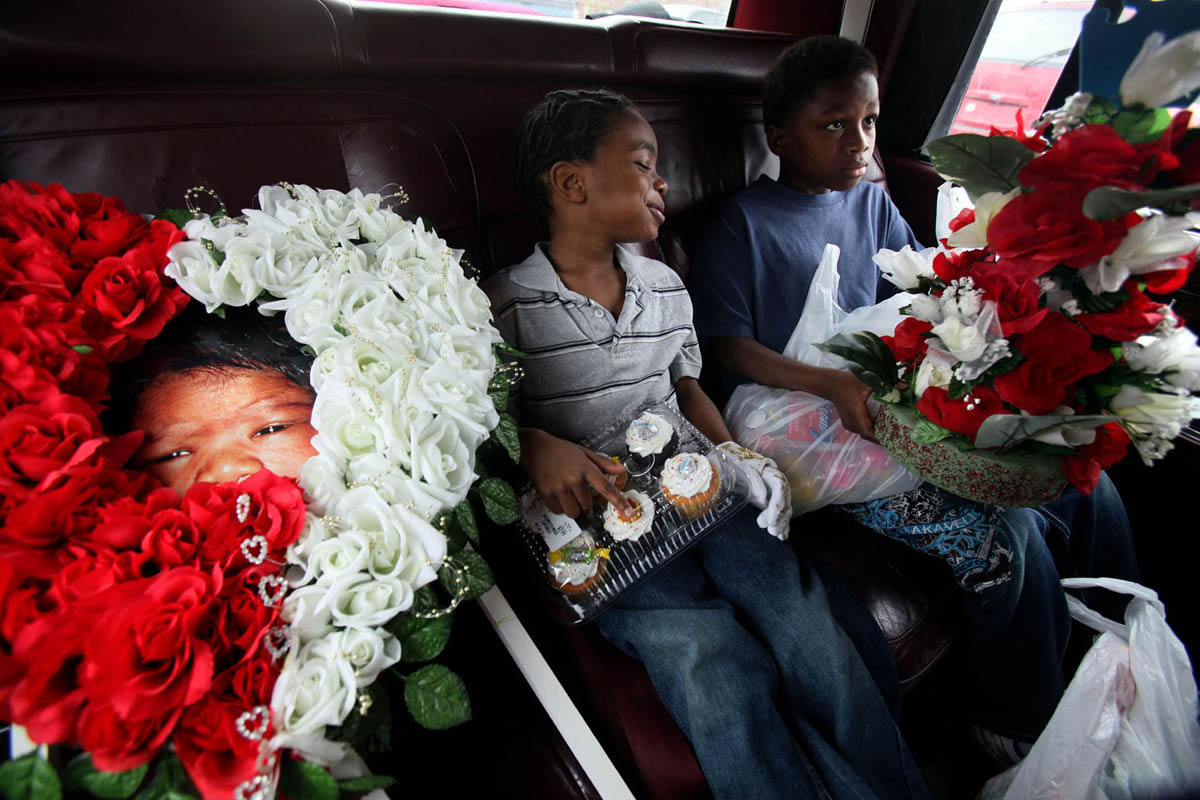 Evans has custody of his two other children, T-Mor Hendrix, 5, (left) and his brother Deshawn Evans, 10. They only know their baby brother through a handful of memories but continue to try and include him in their lives. They have a large photo that they take with them when they visit his grave at the cemetery. On this day, they take cupcakes, flowers and balloons to the grave site to celebrate baby Will's birthday.