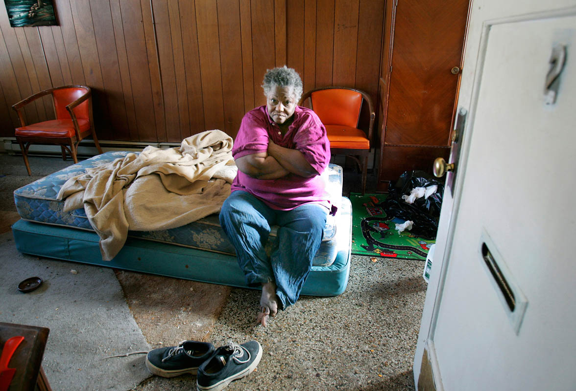 Bessie Johnson sits on a bare mattress soaked in her own urine, January 18, 2006, where she has lived for over 5 years at a boarding home in Milwaukee.