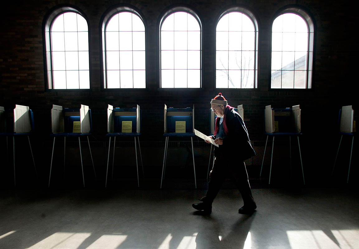John Sternkopf of Milwaukee, Wis. double checks his ballot after voting at the South Shore Park Pavilion.