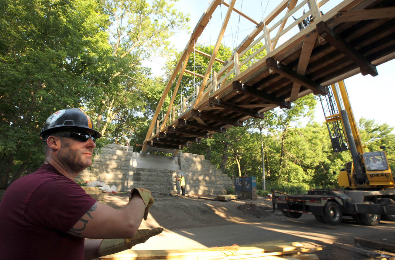 Placement of a new pedestrian bridge in Riverside Park.