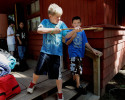 Ian O'Brien, 10, of Steven's Point picks up a stick, using it as an impromptu gun at his cabin. Anger and aggression is common for children who have a parent involved in the war and Ian was very angry when his father had to be deployed. He is attending a free camp with other children who have, will have, or currently have a parent deployed in the war effort.