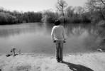 Yolanda Owten stands at the edge of McGovern Park pond, April 17, where the bodies of Quadrevion Henning and Purvis Parker were found after a four-week search. {quote}This is too sad. They are too young,{quote} says Yolanda, who did not know the boys but learned of the story through the news.