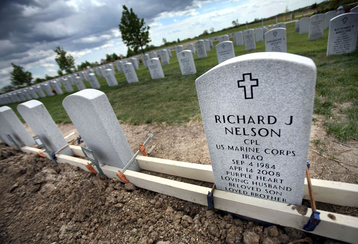 Well after the funeral, Cpl. Ricky Nelson's headstone is engraved, clamped for alignment at the Southern Wisconsin Veterans Memorial Cemetery. The remainder of  the row has blank headstones, an eerie prediction that more soldiers will die, and more families will make the ultimate sacrifice, just as Kristen did.