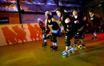 The Crazy Eights cruise their practice track during warm-ups. The team is part of the Brewcity Bruisers Milwaukee Rollergirls, a group that has brought the fun of rollerderby back to the area.