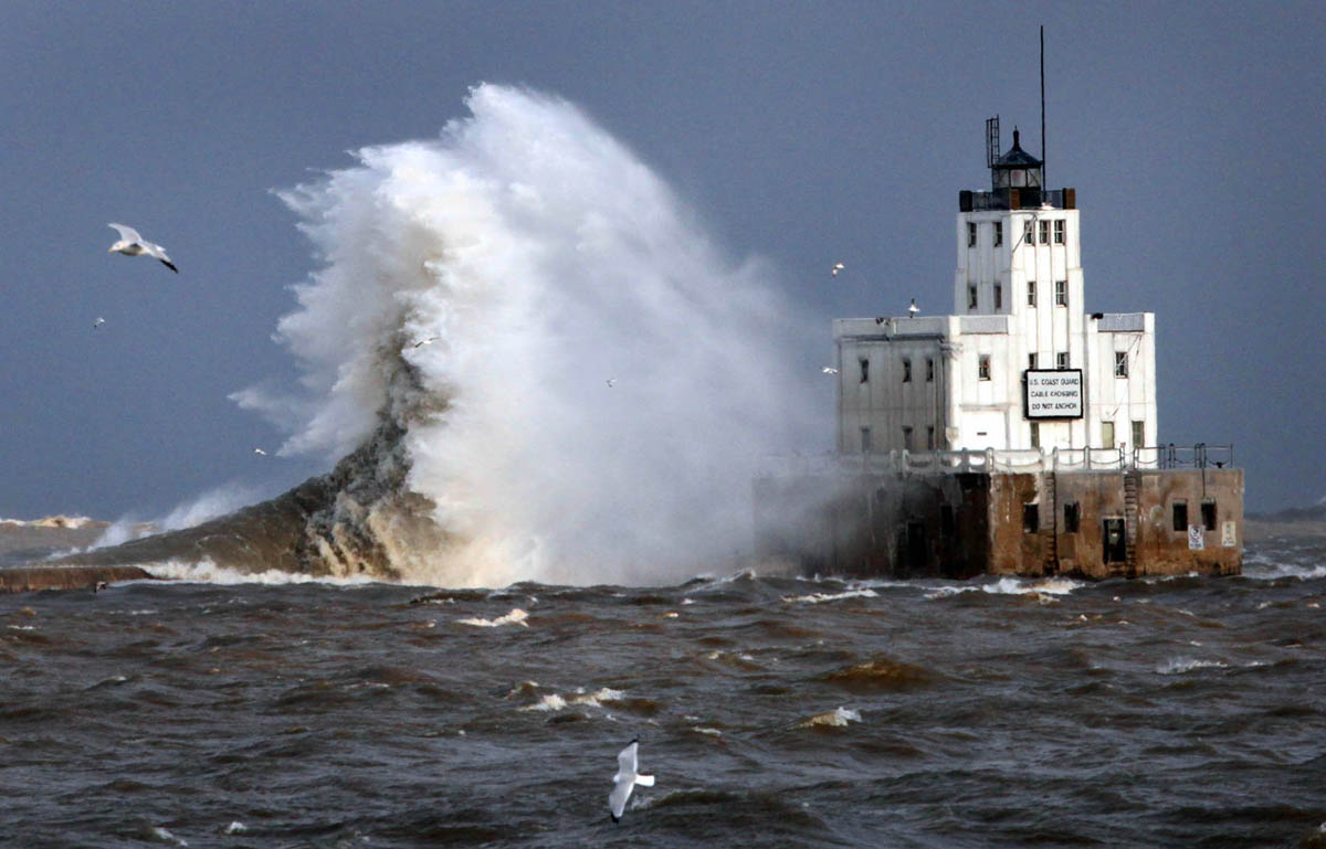 Strong gusting winds drive the waves into the Milwaukee Harbor Lighthouse during a winter storm. The waves were easily clearing the 61-foot tall lighthouse with winds reaching up to 60 miles per hour.