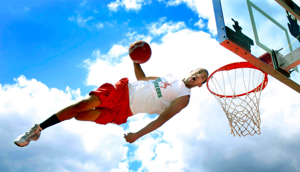 Avery Stribling defies gravity as he performs with the Rim Rockers during the Bucks Experience at Summerfest.