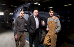 Left to right, Olexiy Miroshnychenko, automotive painter, David Fraser, chief operating officer, and Dmitrii Rozenberg, welder, at INKAS Armored Vehicle Manufacturing, for Manufacturing Automation magazine.