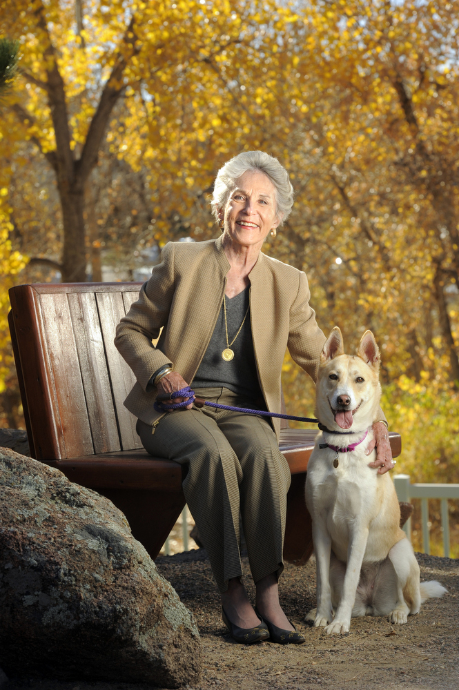 Portrait of Kathi Brock, of the Dumb Friends League, with a canine friend in Denver, Colorado.