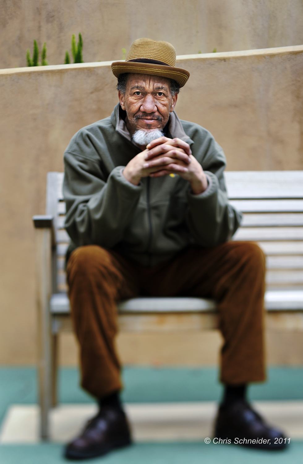 A portrait of a Mercy Housing resident outside his home in San Francisco for the Mercy Housing annual report.