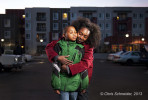 A portrait of a Mercy Housing resident with her son at her home in Denver for the Mercy Housing annual report.