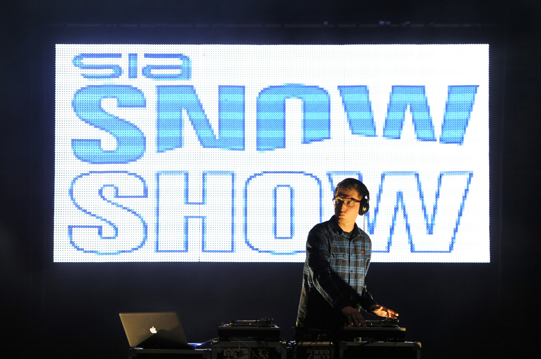 A DJ performs during the fashion show during the SIA Snow Show at the Colorado Convention Center in Denver, Colorado.