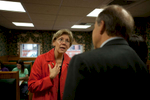 Salem, MA., October 13, 2011: Democratic Senate candidate Elizabeth Warren is on the campaign trail in Salem, MA talking to local business owners. Here she speakes with John Serafini, Jr. a local attorney. Photograph by Evan McGlinn for The New York Times.