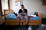 James Moore, 28, of Revere, MA in his bedroom at the Meridian House drug treatment center in East Boston where he is recovering from Oxycontin addiction. East Boston, MA. June 14, 2011. Photograph by Evan McGlinn for The New York Times