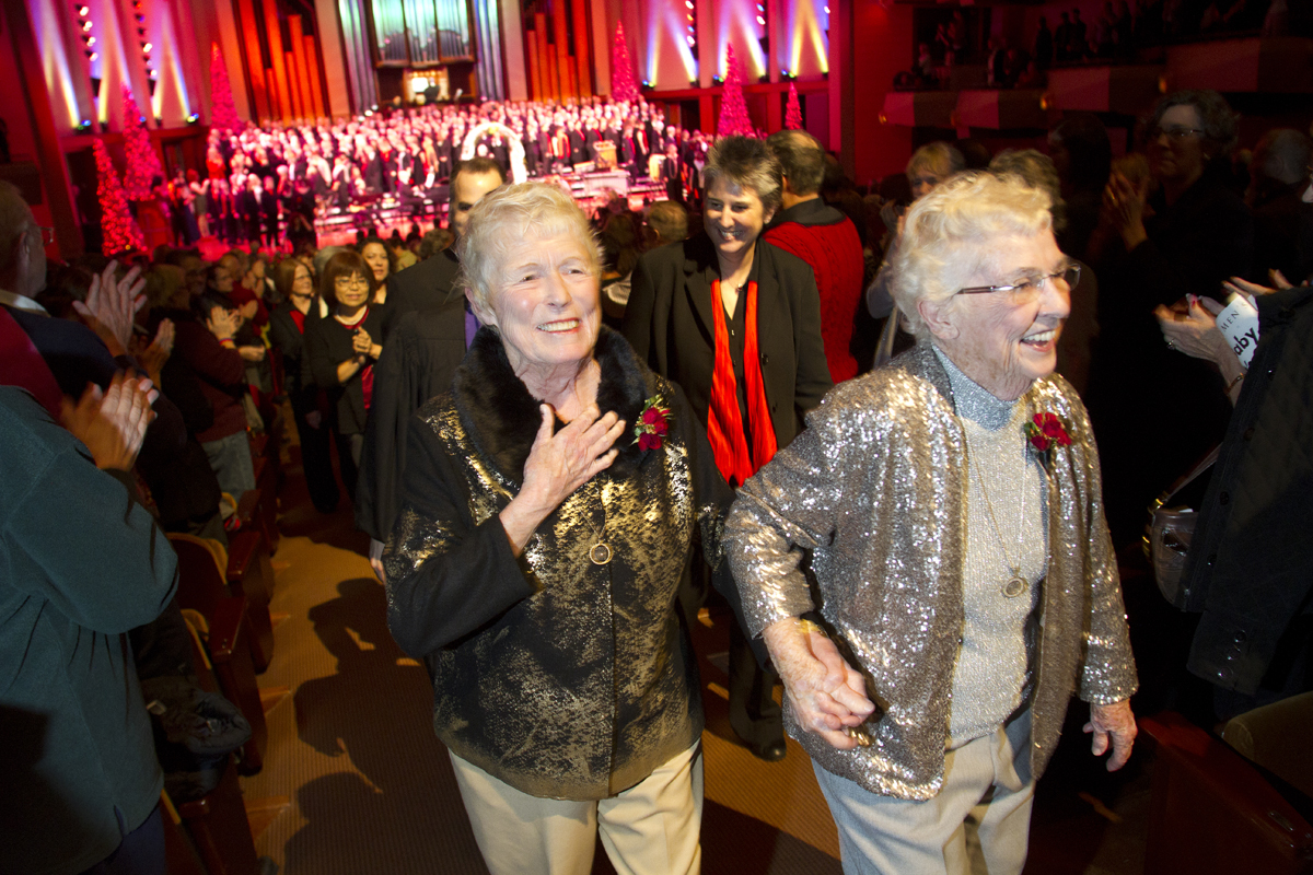 Jane Abbott Lighty, left, and Pete-e Petersen, from Seattle, walk up the aisle after getting married during an interlude in the Seattle Men's Chorus Holiday Concert in Seattle, Wash., on December 9, 2012. Lighty and Peterson, who have been romantic partners for 35 years received the first same-sex marriage license in Washington state after voter's approved to make it legal. {quote}I just can't believe this is happening after all these years,{quote} said Peterson. Donald Jenny (left) and Neil Hoyt, from Bellevue, Wash., who have been partners for 23 years all got married during the ceremony.  © Karen Ducey 2012)
