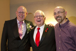 From left to right: Donald Jenny, Seattle Men's Chorus Artistic Director Dennis Coleman and Neil Hoyt, pose for the camera after the Seattle Men's Chorus Holiday Concert / Wedding Celebration in Seattle, Wash., on December 9, 2012.  (© Karen Ducey 2012)