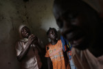 A girl and her mother mourn a relative who died from Malaria in the displaced site of Bossangoa.