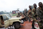 members of the Seleka militia wait outside the Hopital communautaire.this day,the seleka was still controlling mostof the part of the city.