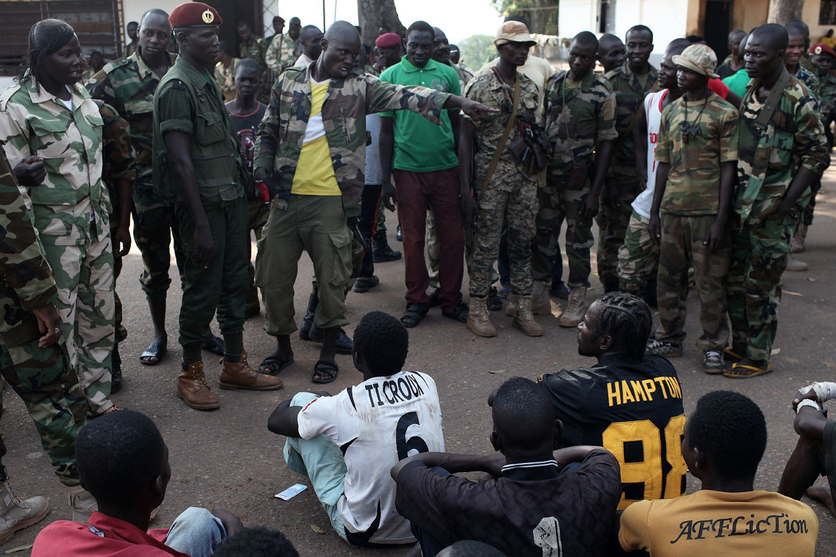 Supposed Anti Balaka prisoners are being shown by the Goverment outside the presidential residence at camp de roux.while journalists were turning their backs, the Seleka soldiers began cursing and threatening the so-called prisoners