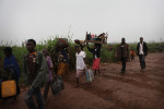 people make their way to the M'poko airport displaced site.