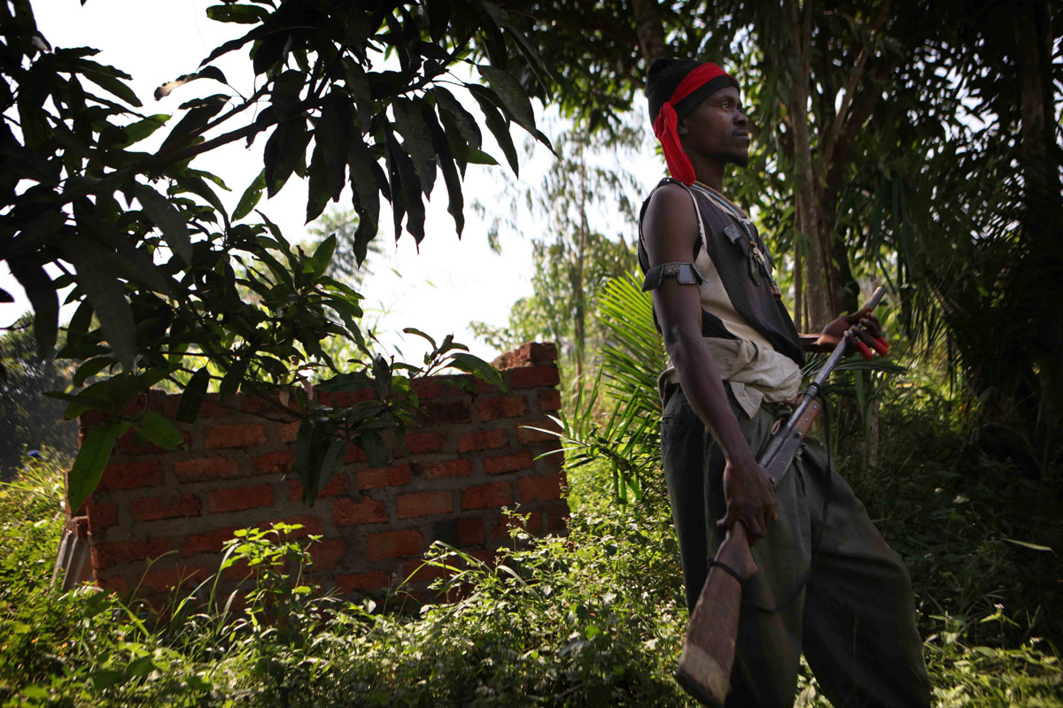 An anti Balaka fighter stand guard in the bush,few kilometers outside Bangui.