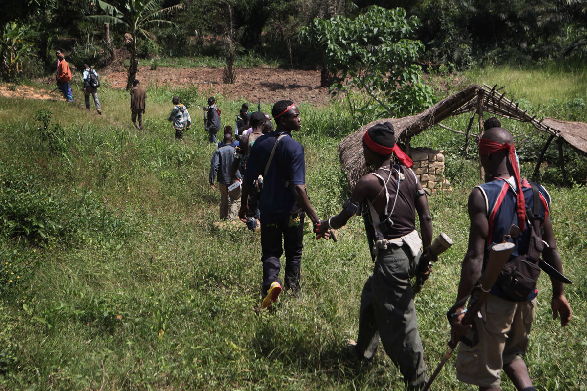 Anti balaka fighters walk in the bush,few kilometers outside Bangui.