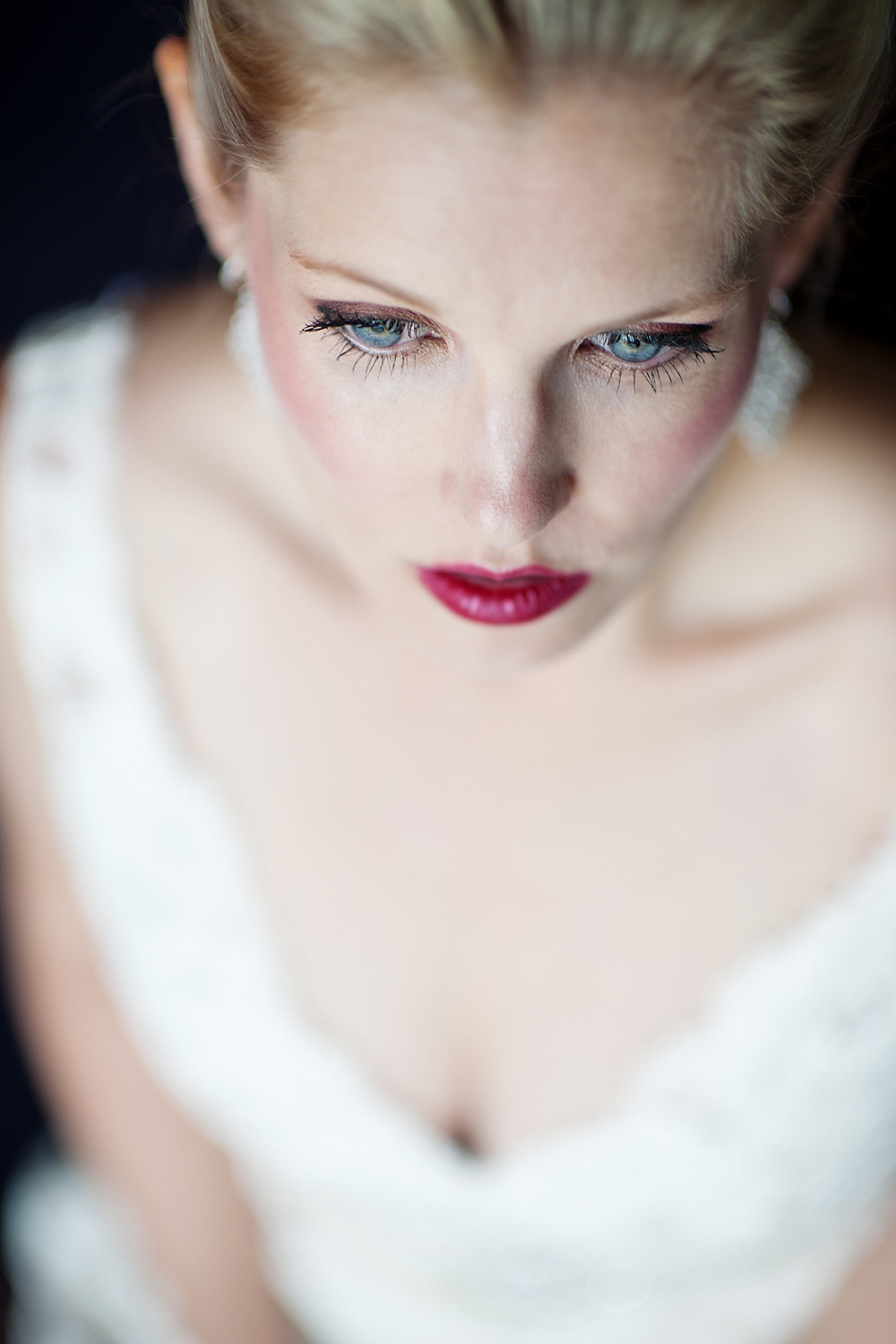high quality bridal portrait with blue-eyed blonde bride and red lipstic