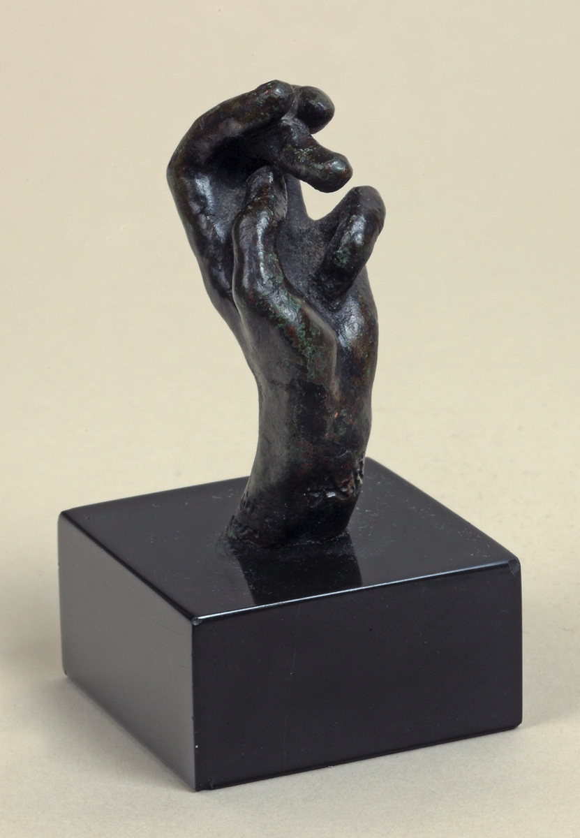 Auguste RODIN (1840-1917)Bronze with black and green patina – sand-cast processHeight 5,4 cmInscribed 'A. Rodin' on the inside of the wrist andWith the foundry mark 'G. Rudier / Fond. Paris' on the outside of the wrist  Conceived between 1890-1908, cast in 1966