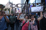 Occupy Wall Street demonstrators march down Broadway in Lower Manhattan.