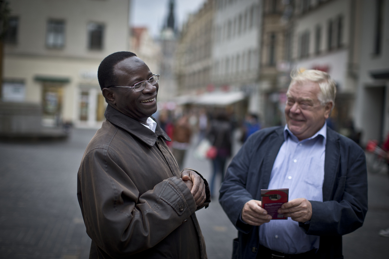 Senegalese born Karambe Diaby , Social Democratic candidate for the German Parliament shares a laugh while being on the campaign trail in his constituency in Halle/Saale. Diaby, a PhD in chemistry, canvassed the former hub for East Germany's chemical industry to become the first black member of the Bundestag in German history.