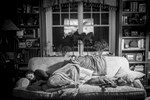 Jessica, Laurel's daughter, takes a nap on the family couch with her dog Nova, who has become like a therapy dog for the entire family. Chappaqua, NY. November 2014.