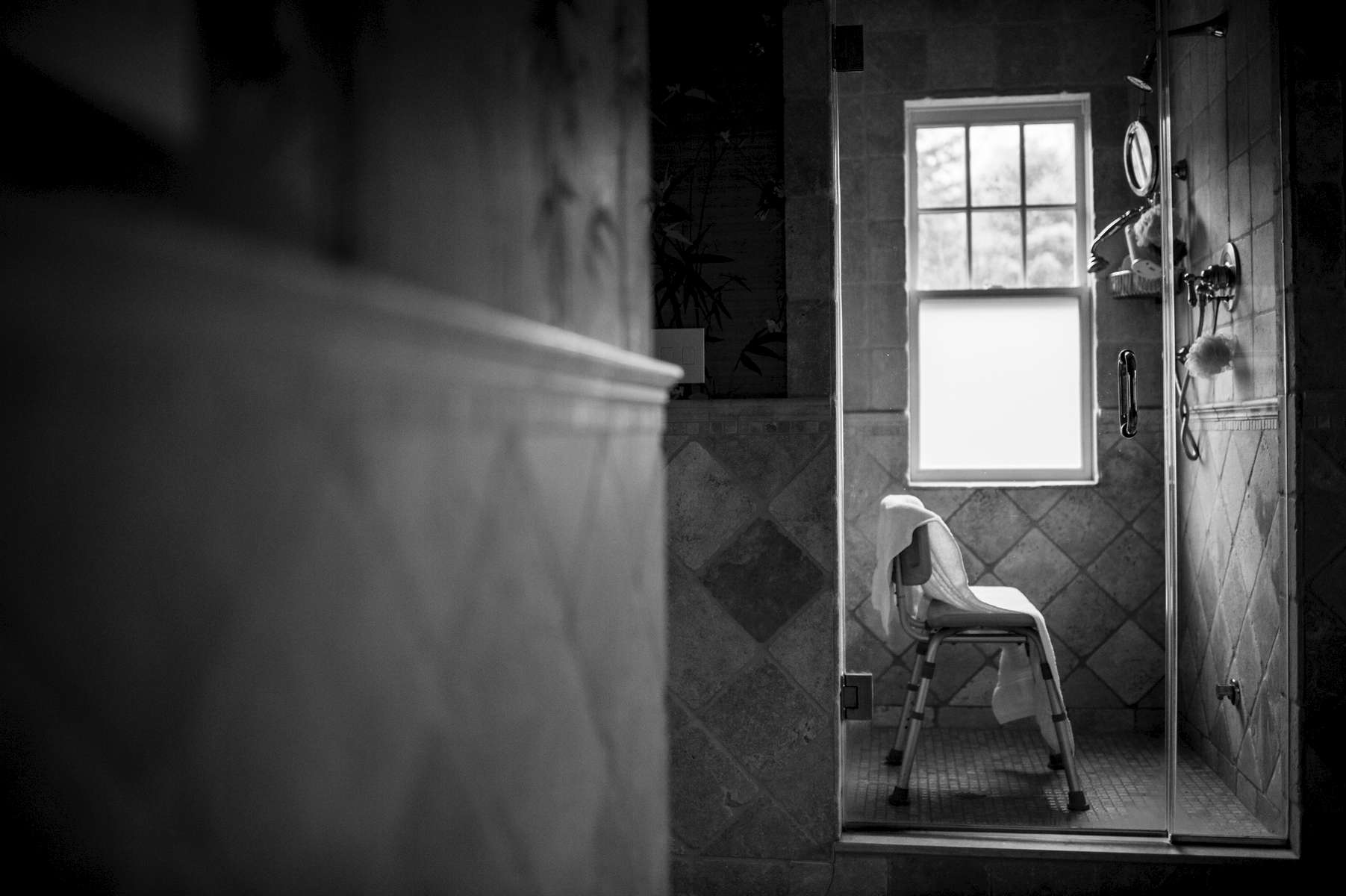 Unable to stand balanced for a long period of time, Laurel receives a bathroom chair from hospice for her to use when she is bathing. She never ended up used this chair. Chappaqua, NY. December 2014.