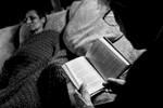 Laurel rests her eyes on the couch while her mother, Marion, reads to her. Chappaqua, NY. December 2014.