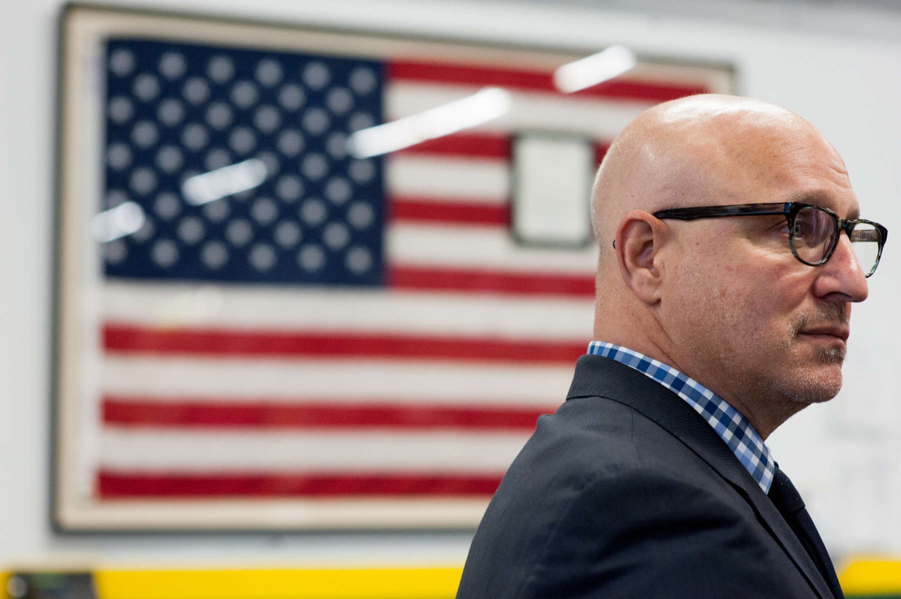 Chef Tom Colicchio, a native of New Jersey, partakes in a public event at the Community Food Bank of New Jersey in Hillside to urge Governor Chris Christie to not make cuts to the SNAP program which helps feed the hungry. (May 13, 2014)Photo by Nancy Borowick