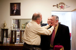 Noble Michael Finocchio, 65, of North Patchogue greets friend and Shriner brother Noble Joe Rizzo, 71, of Sayville, before a meeting of the Kismet Shriners in Hicksville. (Mar. 5, 2012) (Photo by Nancy Borowick)