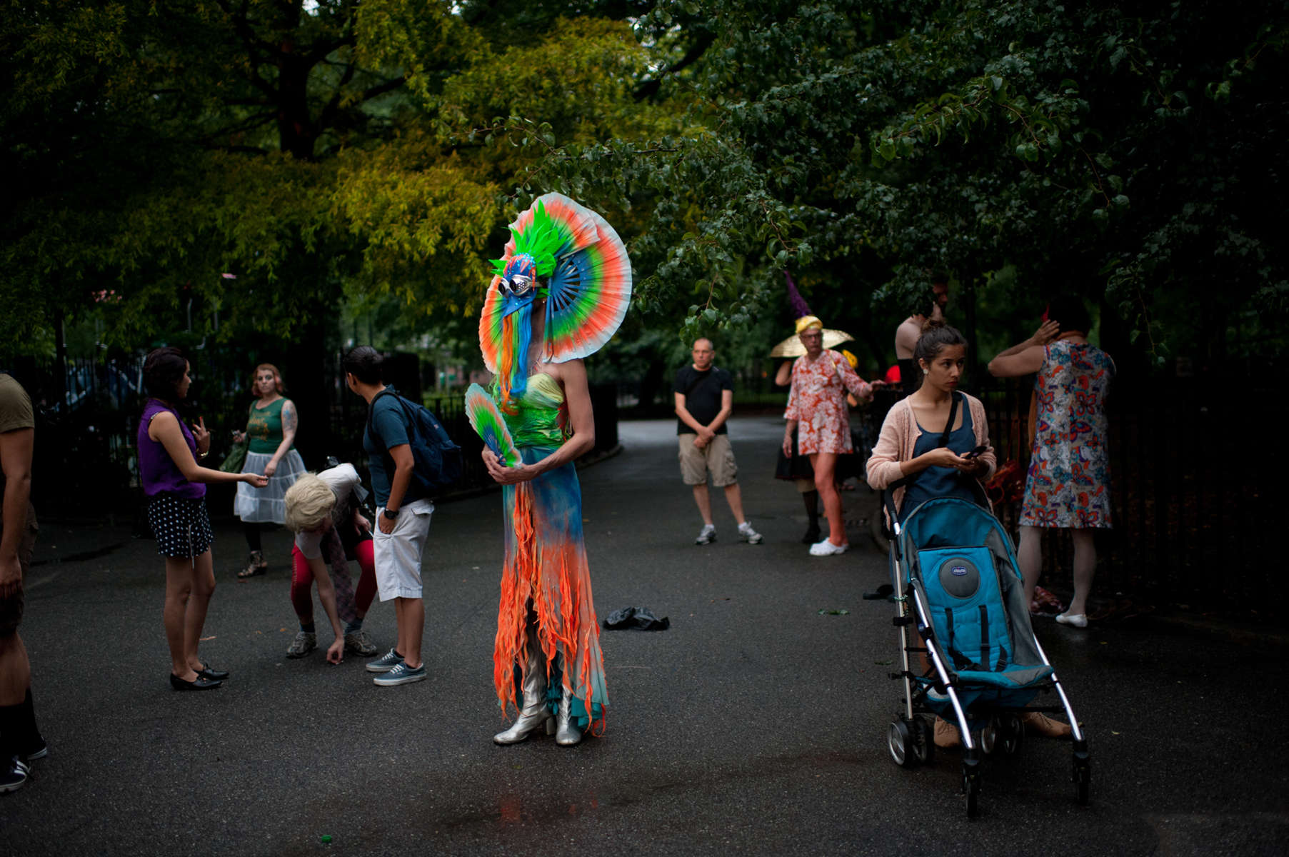 Friends congregate at Tompkins Square Park in the East Village in festive attire before heading to the Stonewall Inn in the West Village during the New York City Drag March.