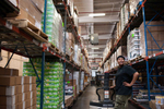 The Community Food Bank of New Jersey is a 285,000 square foot facility located in Hillsdale, New Jersey. Employees of the food bank buzz around the space, moving and organizing items. (May 13, 2014)Photo by Nancy Borowick