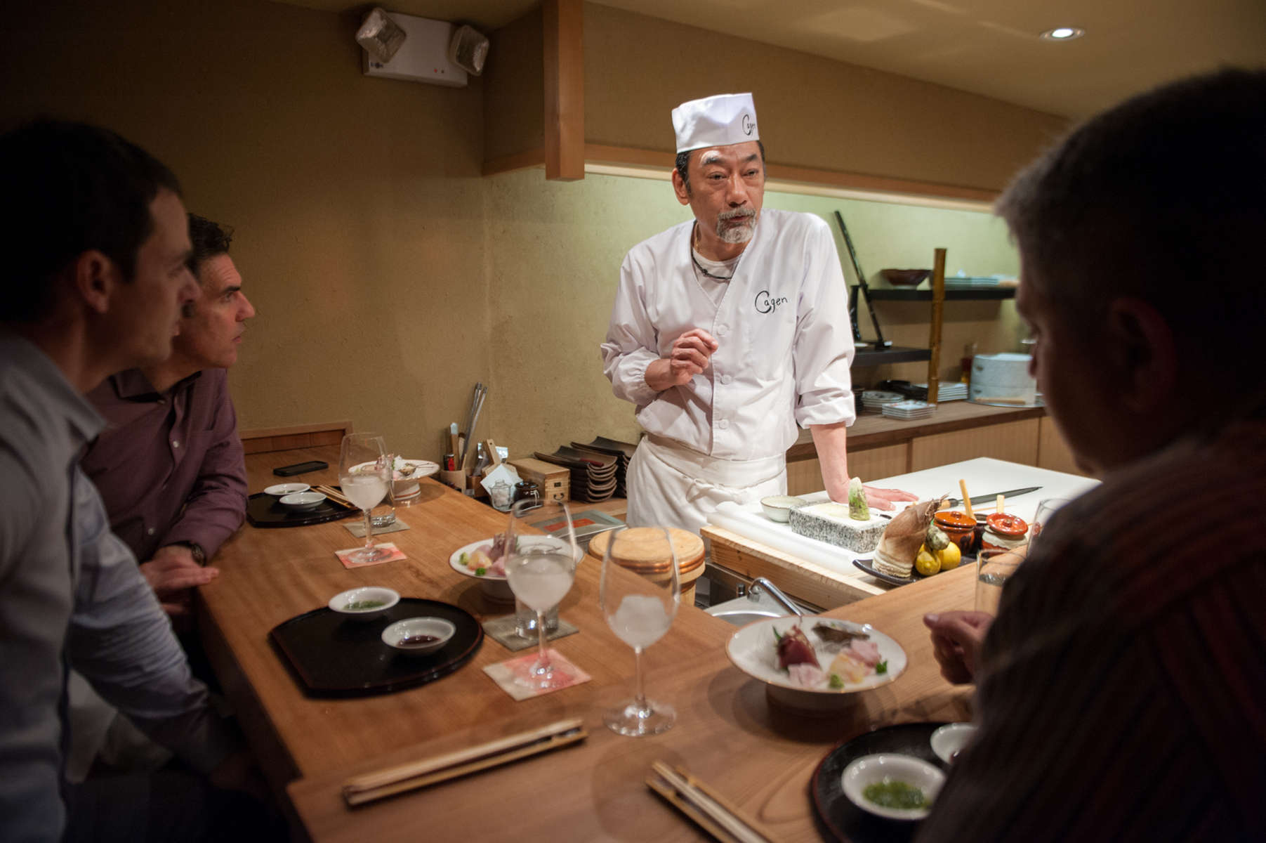 Chef Toshio Tomita presents diners with one of their many courses, offering up a collection of seafood items, such as Snapper, Grouper and baby Bluefish at this East Village establishment. (Apr. 23, 2014)Photo by Nancy Borowick