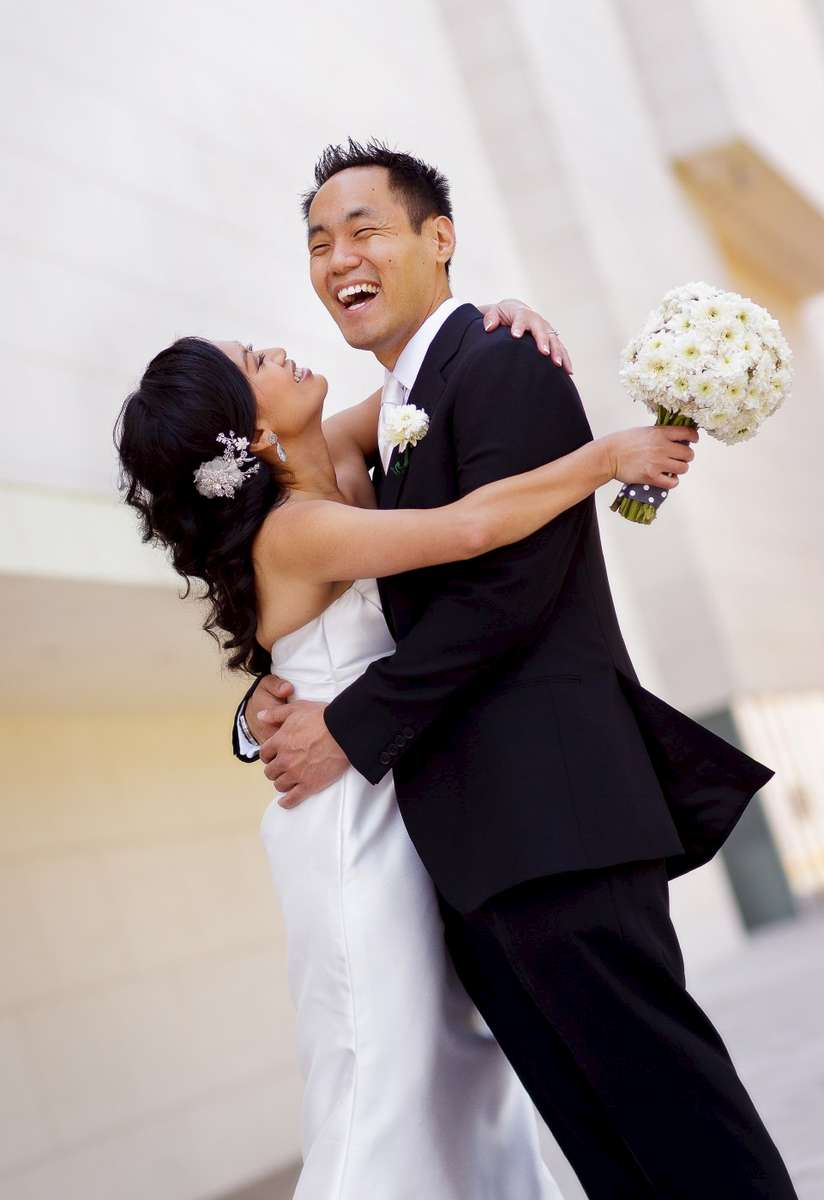 -Ren_e-and-Henry-Segerstrom-Concert-Hall-portrait-with-bride-and-groom