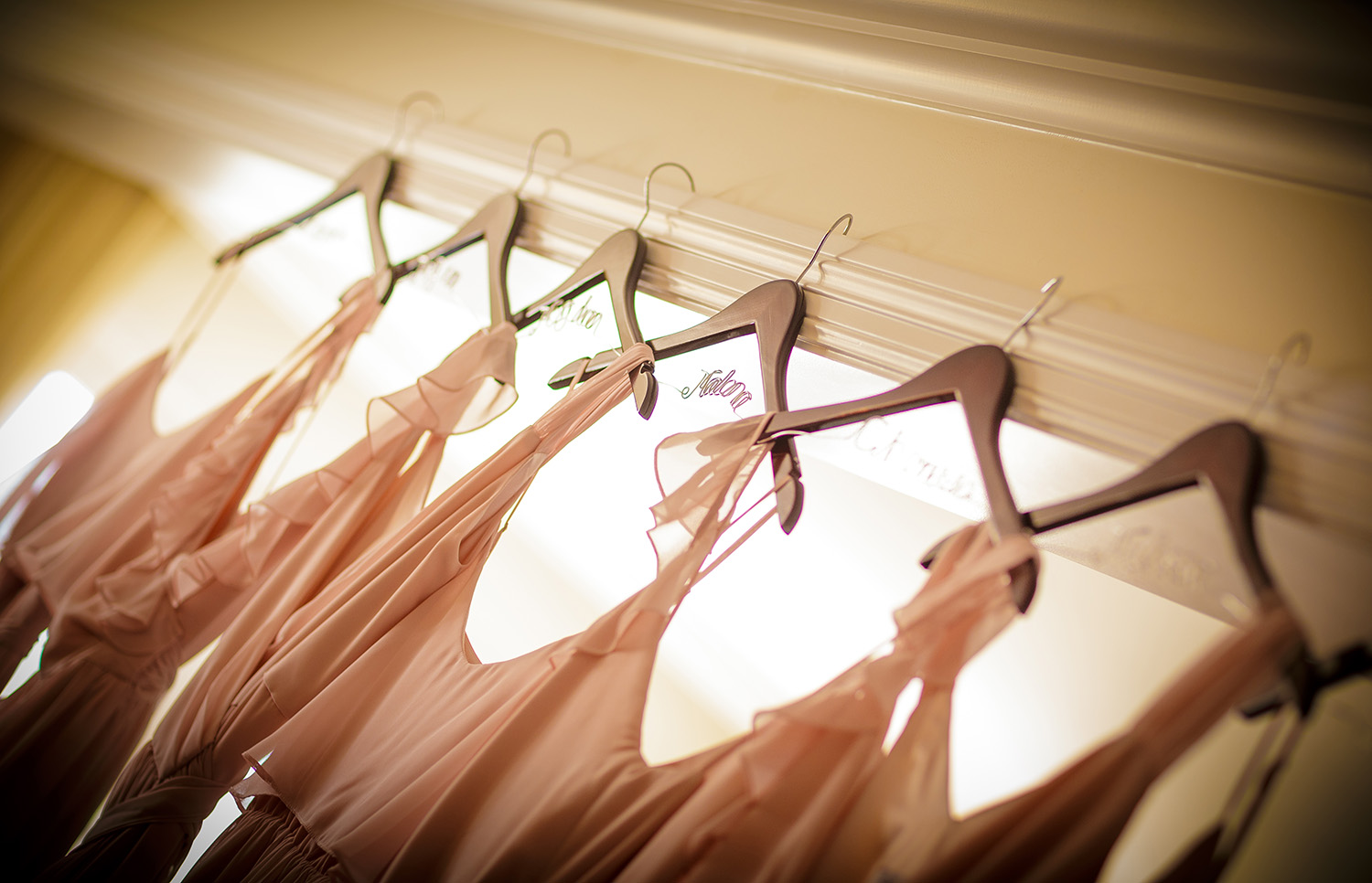 bridesmaid-dresses-hanging-in-window