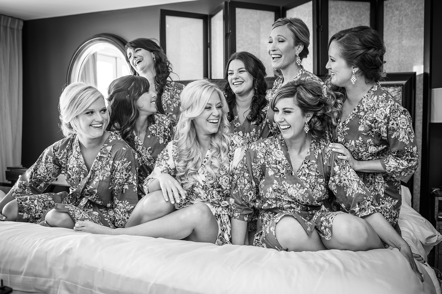 bridesmaids-jumping-on-bed