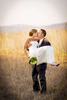 open-field-of-weeds-and-dry-brush-with-bride-and-groom