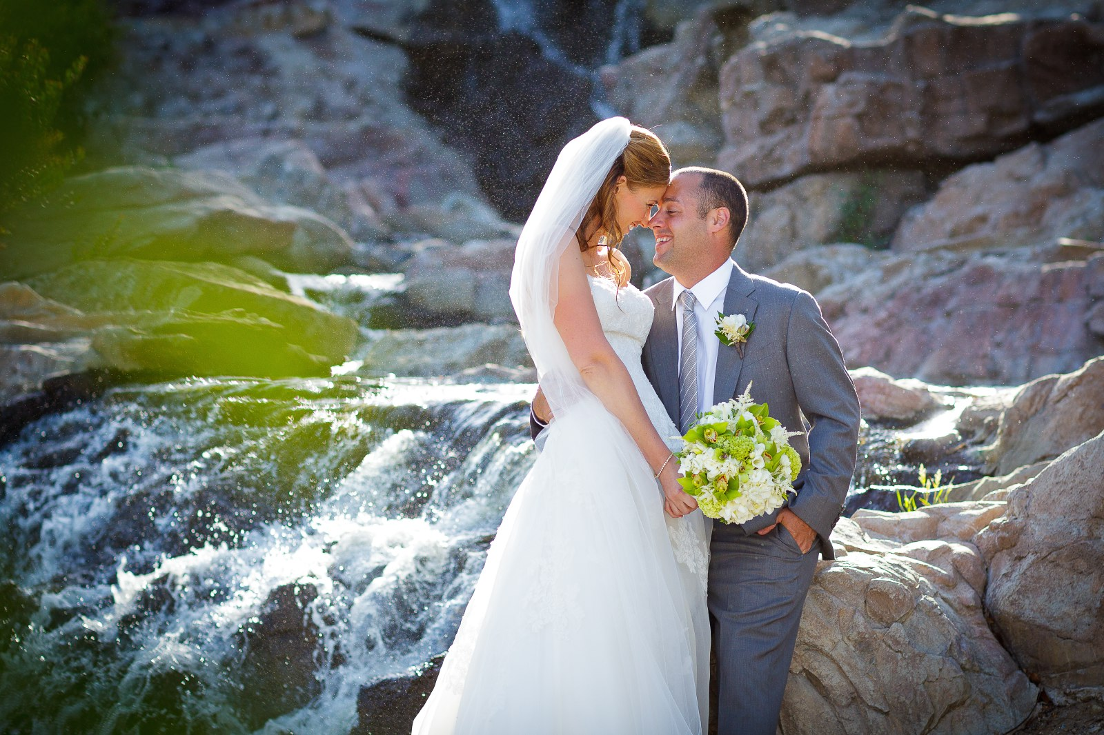 waterfall-at-dove-canyon-with-bride-and-groom-