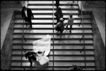 wedding couple decends down stair case at boston public library