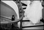 bride walks towards groom for first look in hotel