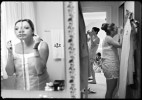 bridesmaids get ready in bride's childhood room