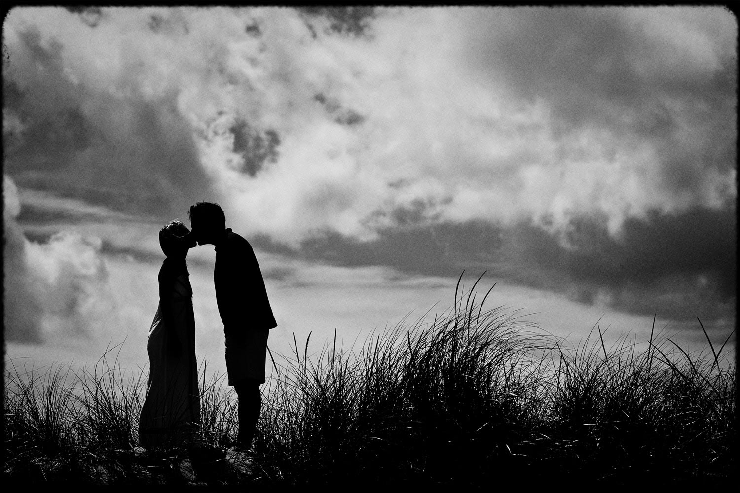 cape_cod_clouds_engagement_beach_black_and_white