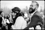 black and white image of wedding couple listening to toast at colorado mountain wedding