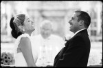 bride and groom laugh at alter during wedding ceremony