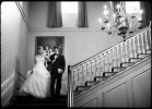 bride and brother decent staircase at crane estate in front of painting