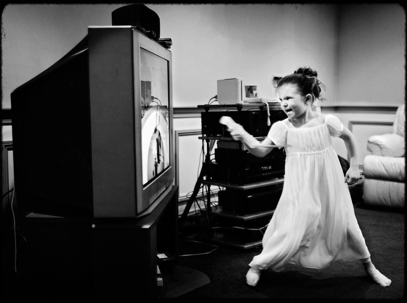 black and white flower girl playing wii